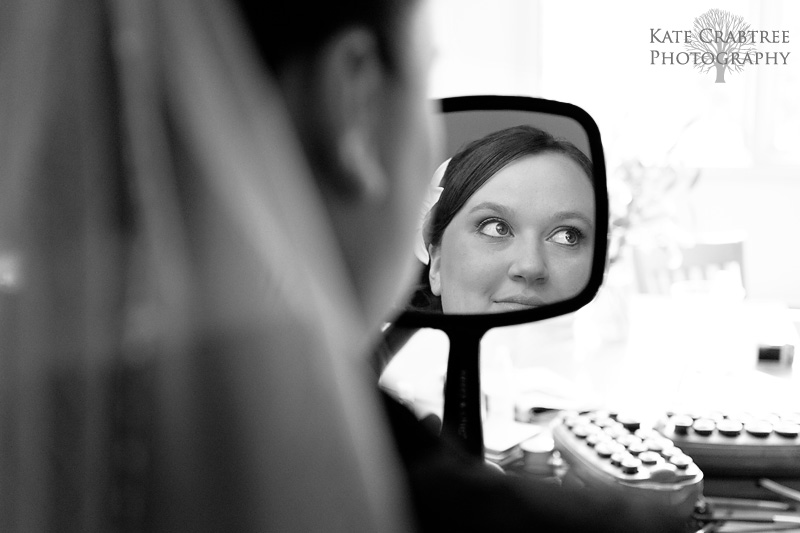 Maine wedding photographer Kate Crabtree took a photo of the bride preparing for her Sunday River wedding