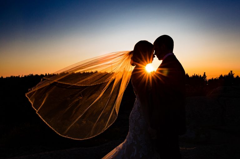 Sunset portraits taken at an elopement on Cadillac Mountain in Acadia National Park