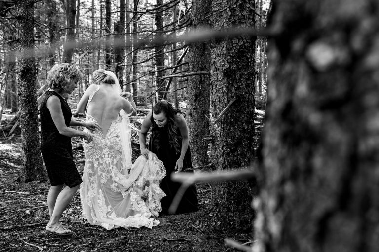 A bride gets dressed in Acadia National Park for her elopement