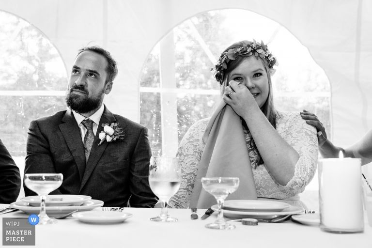 A bride cries at her Sugarloaf Mountain wedding in Western Maine