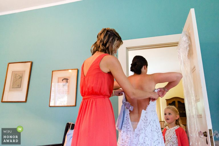 A bride gets dressed at her Blue Hill Maine wedding