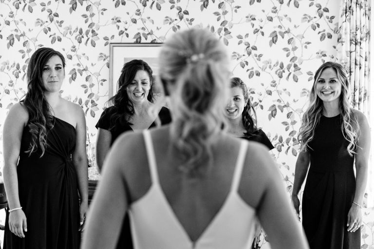 A bride prepares at the Asticou Inn for her Northeast Harbor Maine wedding.
