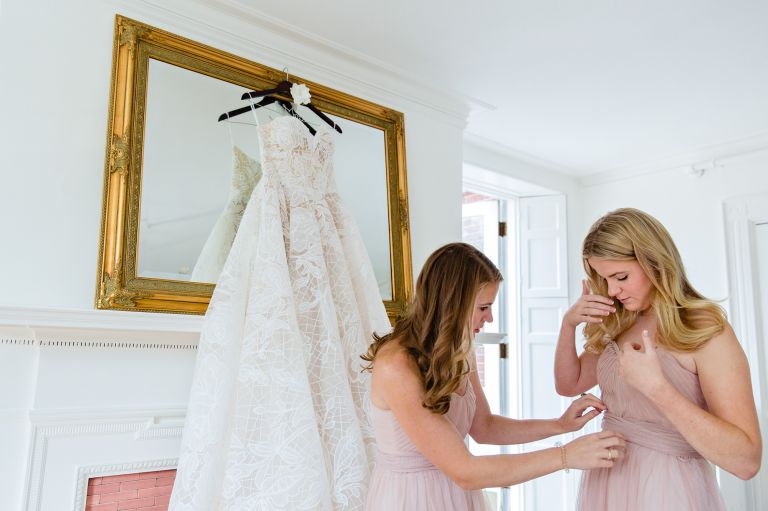 The bride gets ready for her wedding with her bridesmaids at the Blind Tiger in Portland Maine