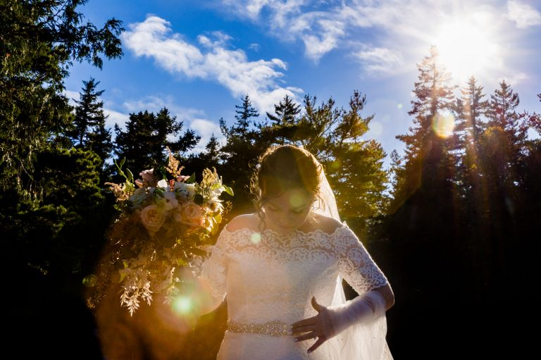 A bride prepares for her elopement in Acadia National Park